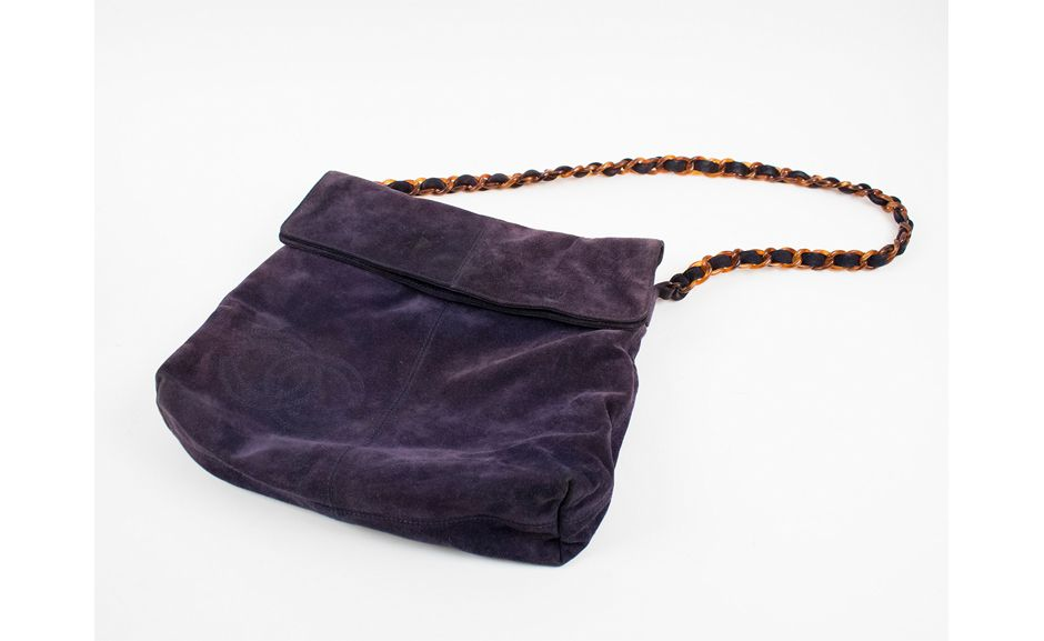 Lot 471  PURPLE SUEDE CHANEL HANDBAG  Estimate: £200-300