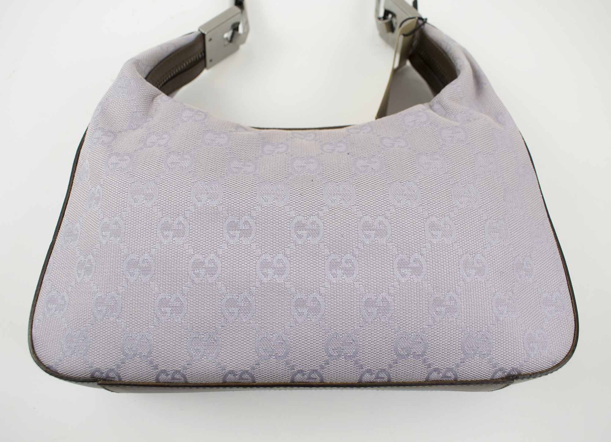 cdabda37e6aa GUCCI MONOGRAM LILAC CANVAS HOBO BAG, with brown leather trim and shoulder  handle, silver tone hardware, with dust bag, 25cm x 16cm H x 5cm.