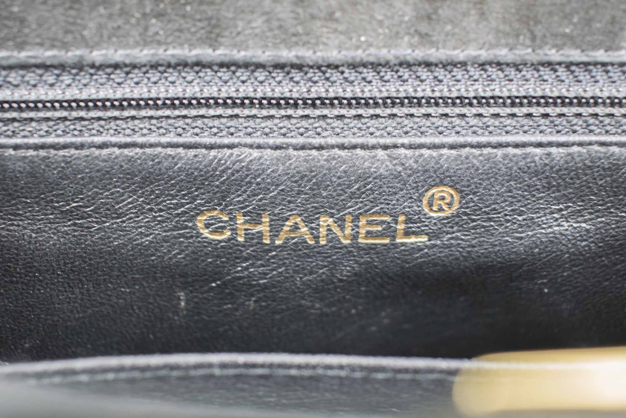 b93e0b47a2ffc6 CHANEL VINTAGE TRAPEZE SHAPE BAG, black suede quilted pattern with two top  handles, black leather interior, iconic interlocked CC lock, gold tone  hardware ...