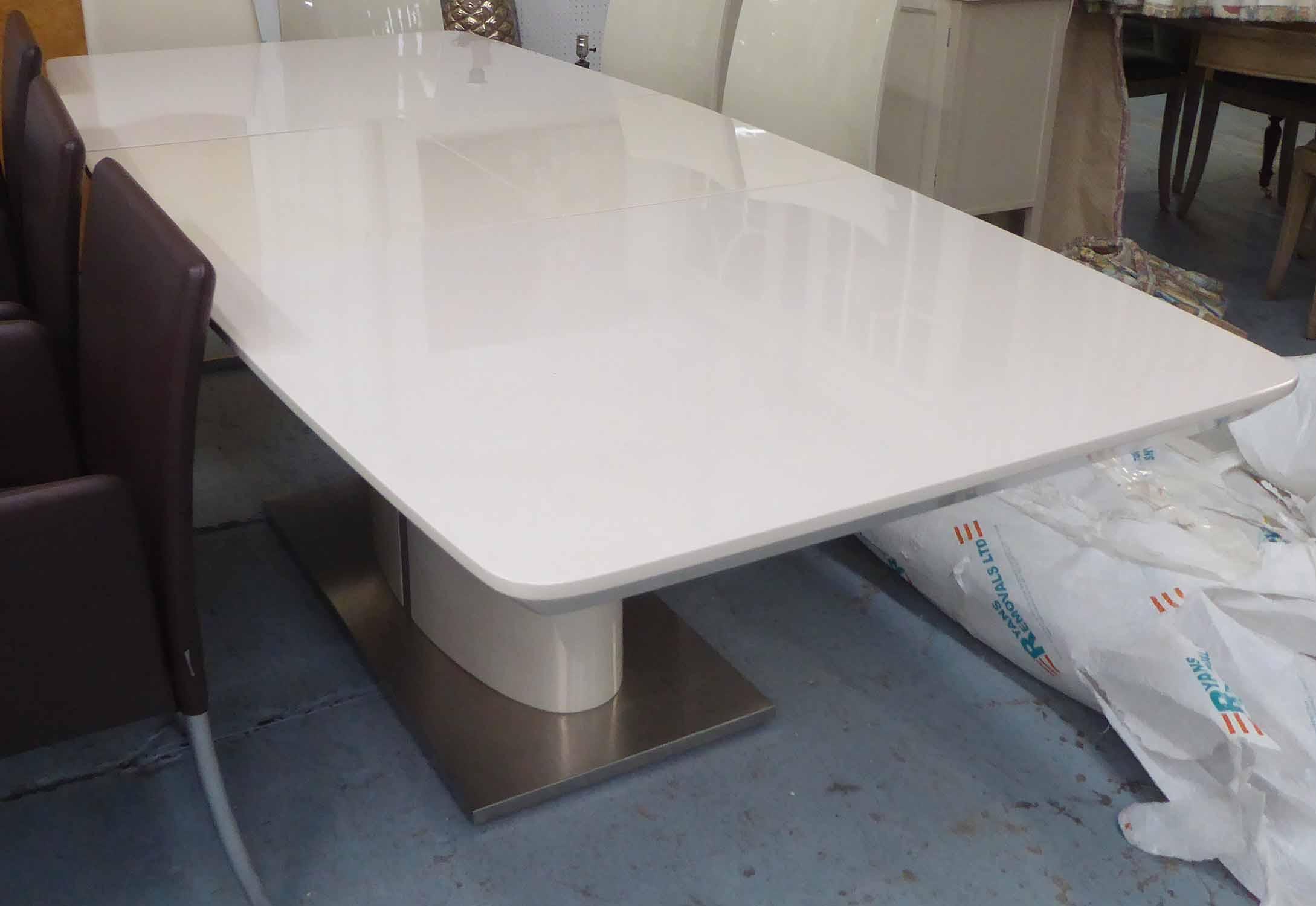 Extending Dining Table In White Melamine Finish On Central