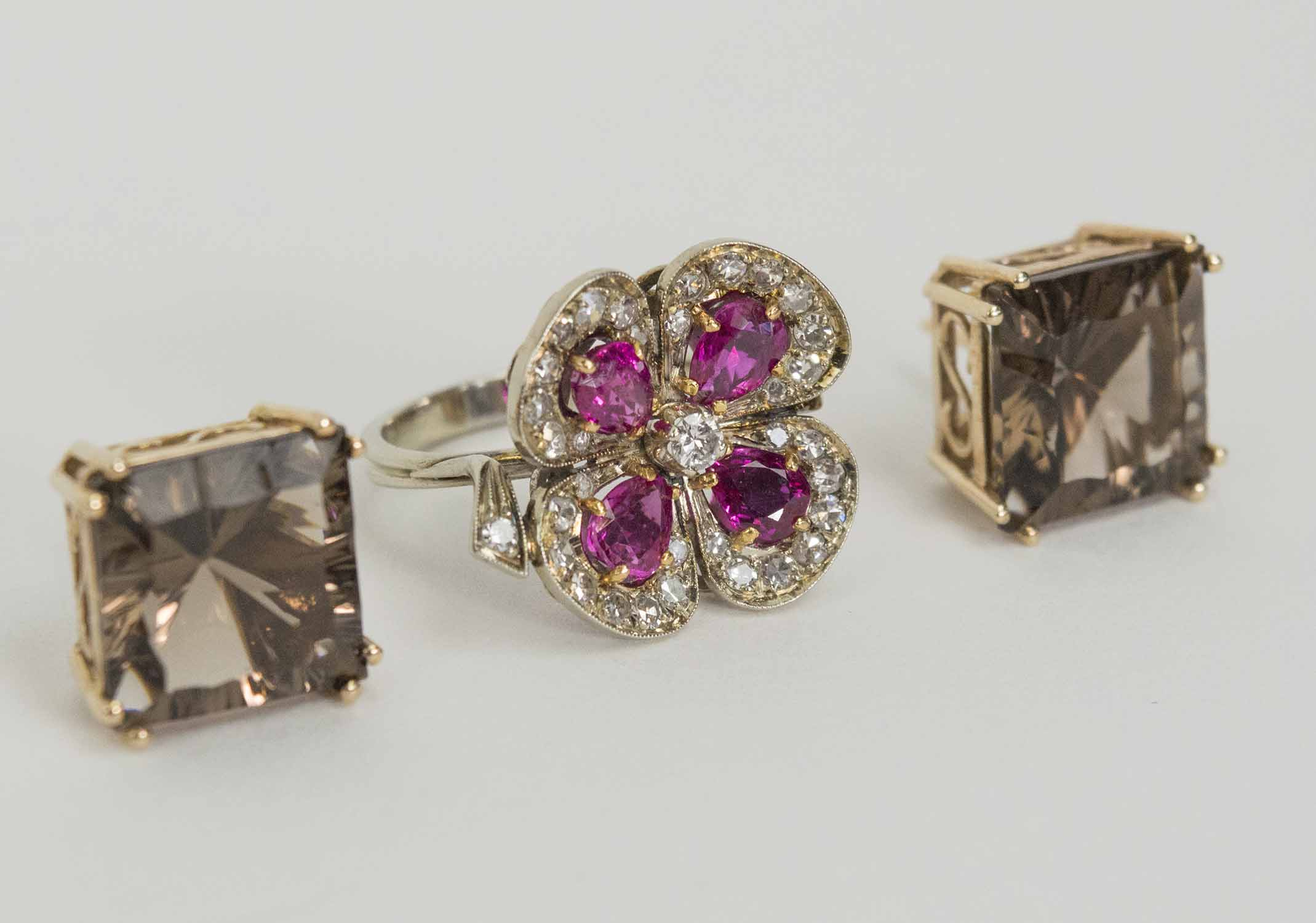 693c4986fd763f RUBY AND DIAMOND RING, of quatrefoil design, and a pair of smokey ...