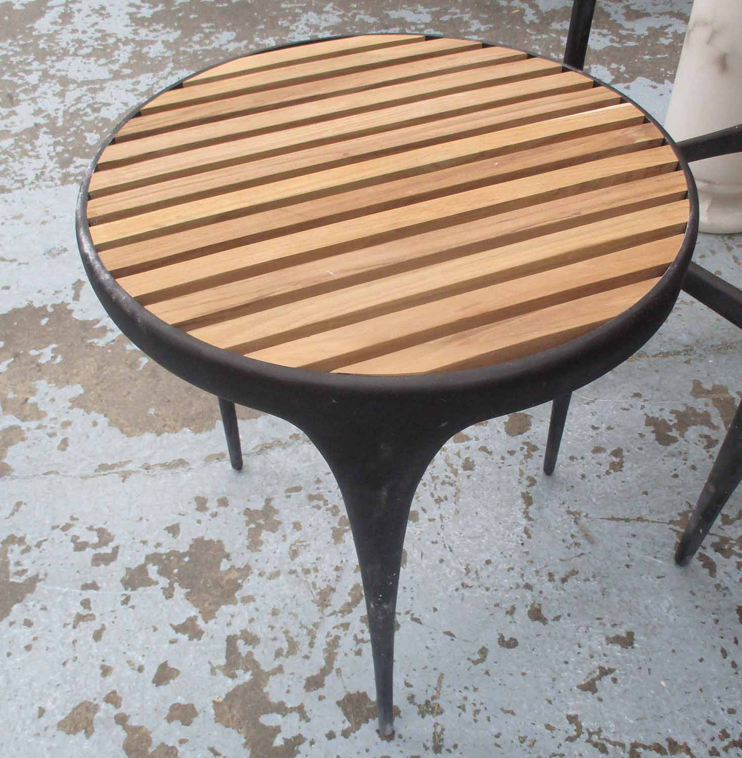 SIDE TABLE, circular slatted top on cast iron frame by